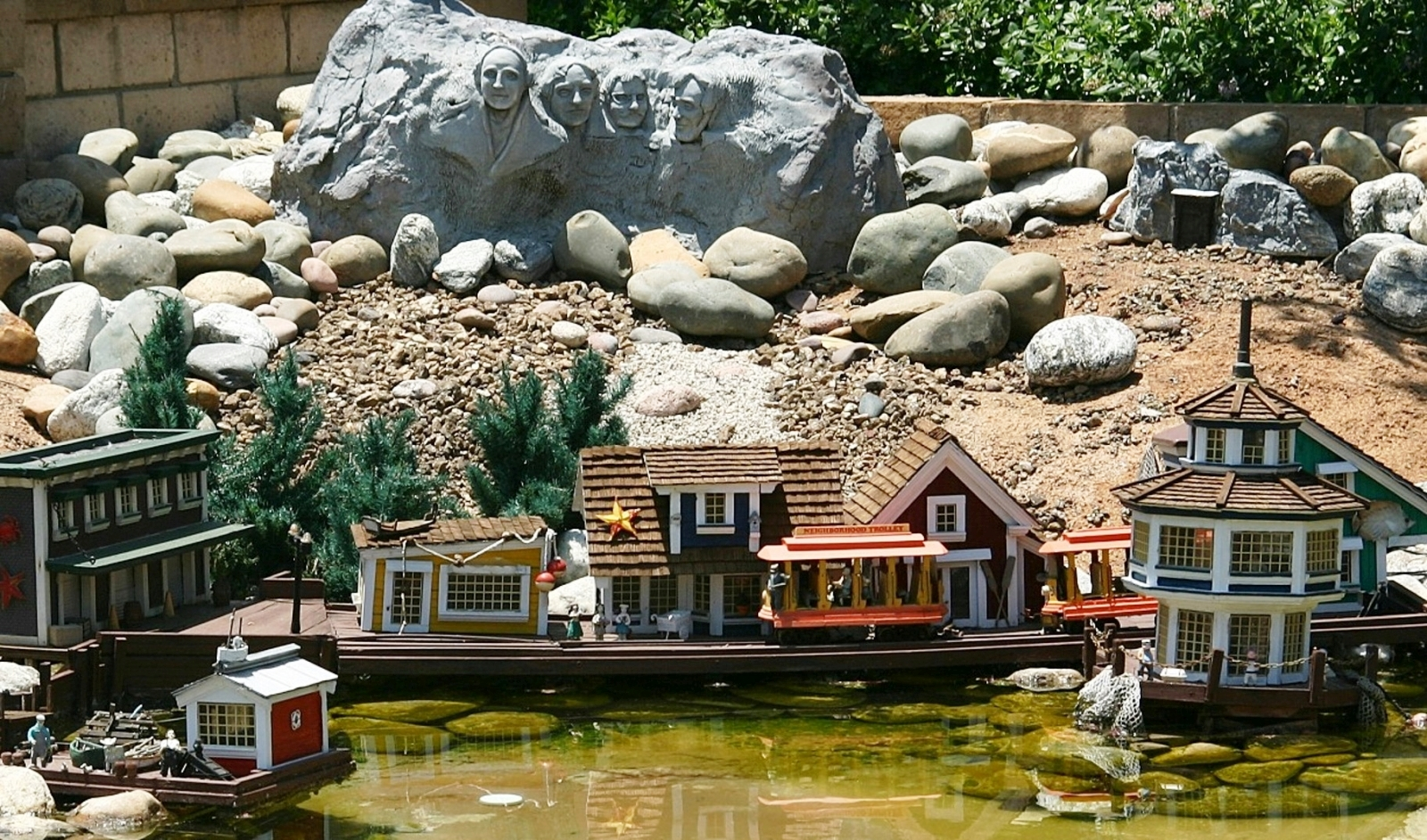 The faces of Mount Rushmore look down over a quaint and peaceful New England harbor town